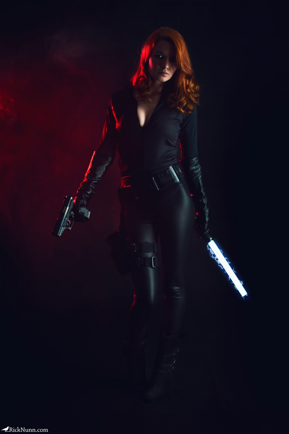 Black Widow - Strobist Portrait of Spadge as Black Widow with Gun and Glowing Baton Photographed by Rick Nunn